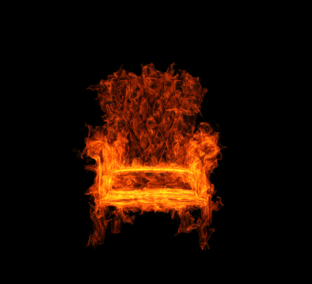 burning armchair on the black background